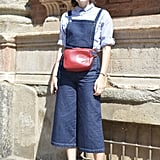 Take overalls to the next level by opting for a wide-leg style and pairing them with a chic fanny pack.