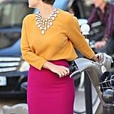 A jeweled bib necklace lent a glam finish to ladylike colorblocking.