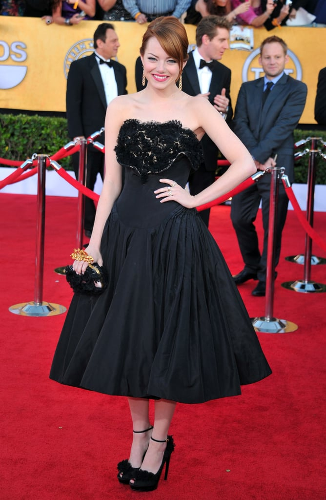 Emma Stone wore Alexander McQueen to join the fun on the red carpet at this evening's SAG Awards in LA. It's a big night for Emma and her many costars from The Help. The whole gang is up for outstanding performance by a cast in a motion picture, and Viola Davis is in the running for outstanding performance by a female actress in a leading role. Jessica Chastain and Octavia Spencer have a friendly rivalry in the best supporting female actress in a supporting role, along with The Artist's Bérénice Bejo, Bridesmaids's Melissa McCarthy, and Albert Nobbs's Janet McTeer. Emma has made many award season stops so far, hitting the Golden Globes, the People's Choice Awards, and the Critics' Choice Awards. Nonetheless, Emma and her The Amazing Spider-Man costar Andrew Garfield took a quick jaunt to Japan for one of their first press duties. Andrew, who's Emma's real-life leading man, didn't join her for a photo op this evening, but we'll see lots of the duo in the months to come. Make sure to vote on Emma's SAG look, and more, in our love it or hate it polls!