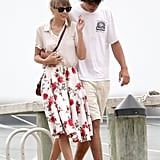 Breezy separates are key — Taylor proved this in spades in her classic white button-up and vintage rose-printed skirt.