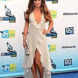Lea Michele took the plunge (literally) in a deep-V, ruffled-neckline dress, courtesy of Giorgio Armani. The off-white creation, spotted at the 2012 Do Something Awards, also showed off her legs, revealing sexy snakeskin sandals by Jenni Kayne. Her Fendi clutch provided that final pop of sparkle.