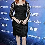 Christina Hendricks showed off her curves in a black lace Dolce & Gabbana confection.