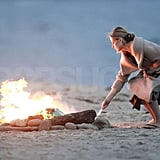 Sarah Michelle Gellar leaned over the fire.