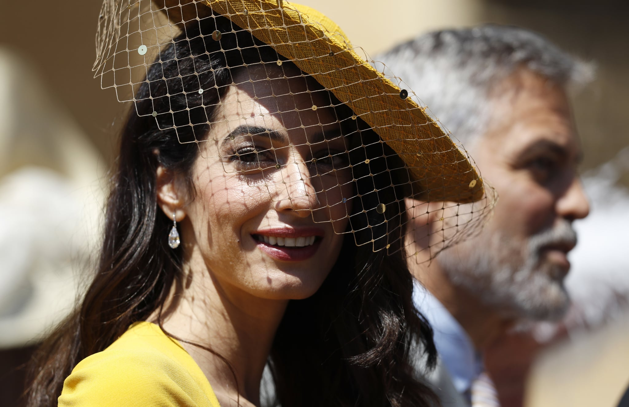 WINDSOR, UNITED KINGDOM - MAY 19:  Amal Clooney and George Clooney arrive at St George's Chapel at Windsor Castle for the wedding of Prince Harry and Meghan Markle on May 19, 2018 in Windsor, England. (Photo by Alastair Grant - WPA Pool/Getty Images)