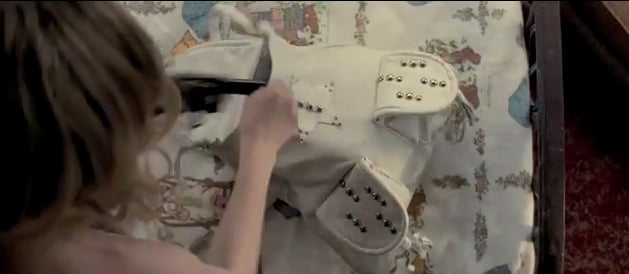 Luli's white studded bag.  Get a similar white studded bag here.