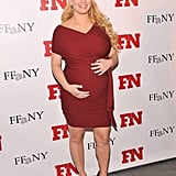 Jessica Simpson held her baby bump for the cameras.