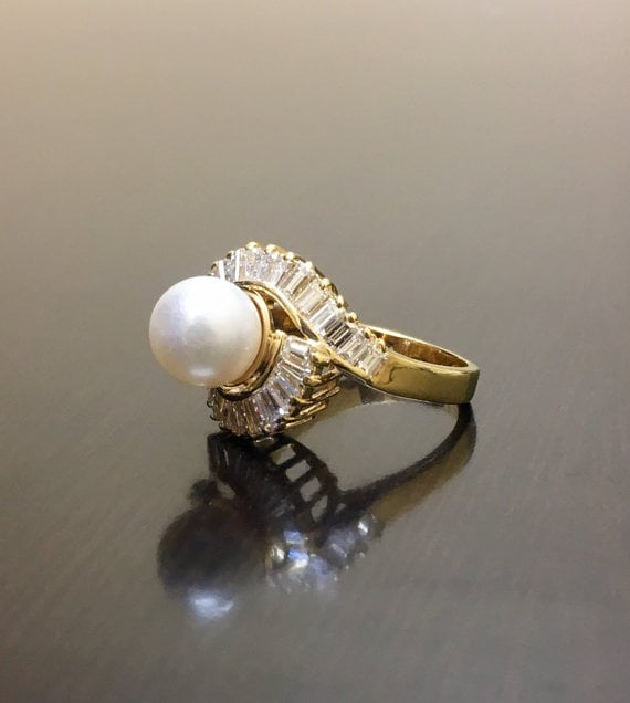 This handmade pearl ring ($3,500) features a set of baguette diamonds that will dazzle any bride.