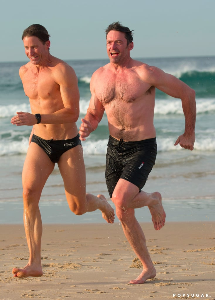 Hugh Jackman On The Beach With His Trainer August 2017