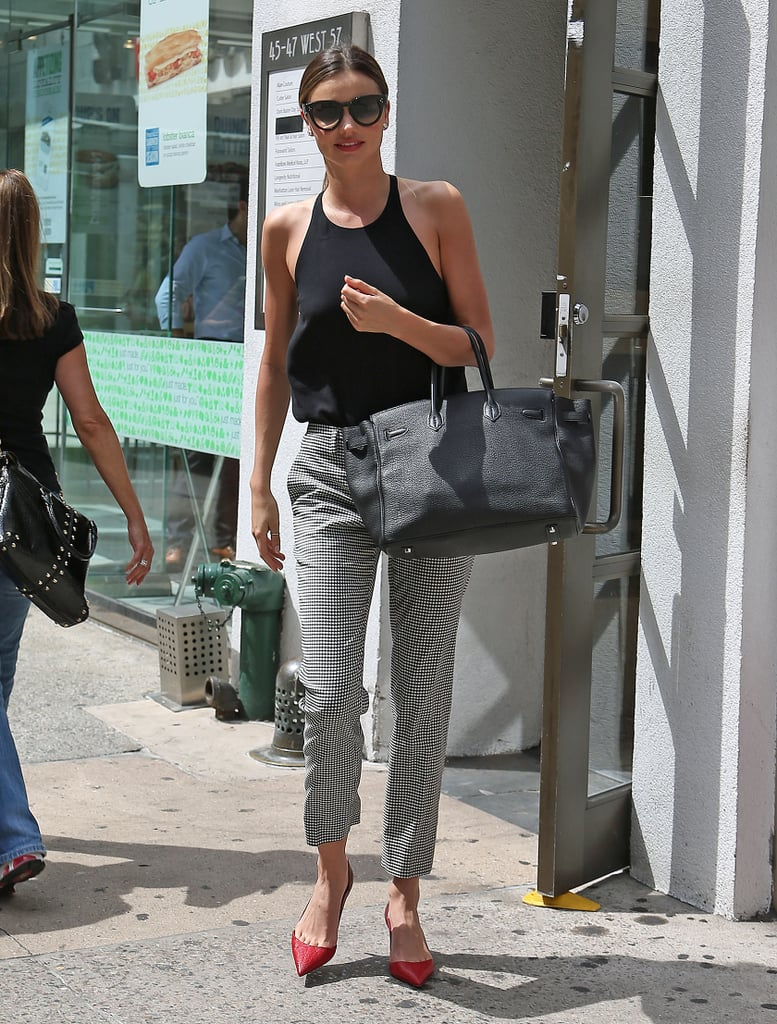 Miranda Kerr's cropped pants and black tank were punctuated