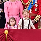Prince George and Princess Charlotte must have known the cameras were watching when they flashed these sweet expressions from the balcony of Buckingham Palace in June.