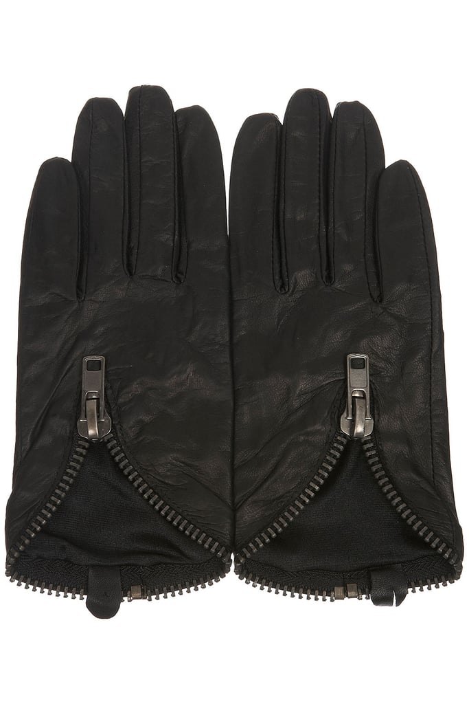 Driving gloves give an instant vibe of riding through Rome on a Vespa, and Jenny incorporates them into her look after spending time with David's friends. Topshop Chunky Zip Leather Glove ($48)