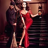 "Penélope Cruz wore a red lace Marchesa gown and acted out the ""passing the broom above the feet"" superstition for Campari's 2013 calendar."