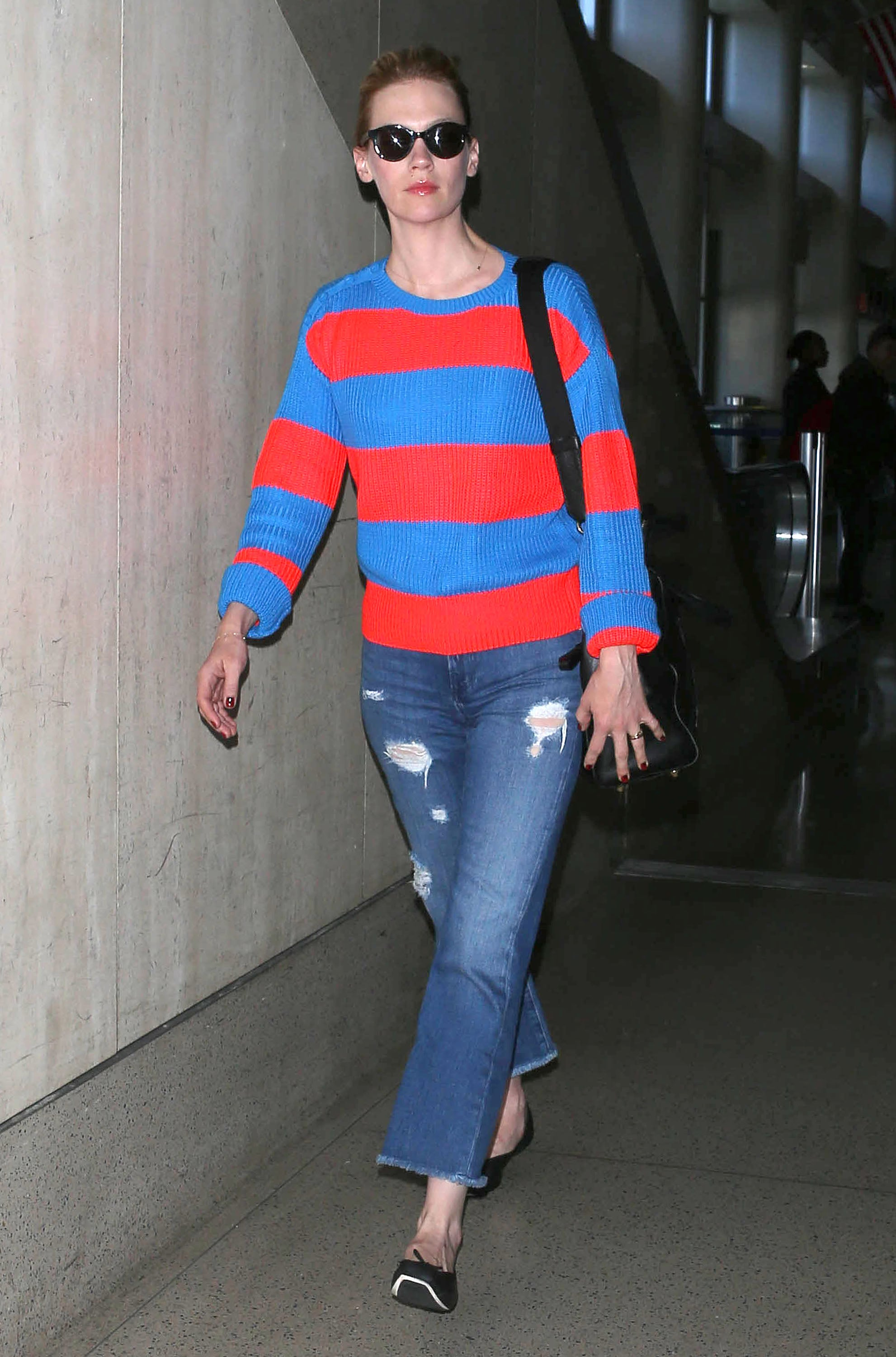 You don't have to be traveling to re-create January Jones's airport look. Just find a bold red-and-blue striped top, then add distressed denim for a cool finish.
