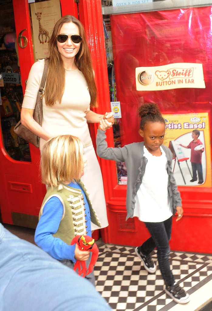 Angelina Jolie ventured into London this morning to shop with her daughters, Shiloh and Zahara Jolie-Pitt. It was the trio's latest outing to buy toys after they picked up some goodies together last week at Ozzie Dots in LA. Angelina bought a vikinig helmet for Shiloh, as well as a fairy ensemble for Zahara. This time, the girls stopped at a store in the neighborhood of Richmond. The Jolie-Pitt kids have been treated to a few adventures during their stay in England, including yesterday's aquarium excursion and a Friday spent watching Harry Potter and the Deathly Hallows Part 2. Angelina had alone time with young Vivienne Saturday, buying flowers, before the busy mom met up with Brad Pitt for an adults-only meeting at the Dorchester Hotel.