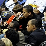 President Obama enjoyed a Chicago Bulls game with a beer in 2009.