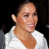 Meghan kept the neckline relaxed in an open style.