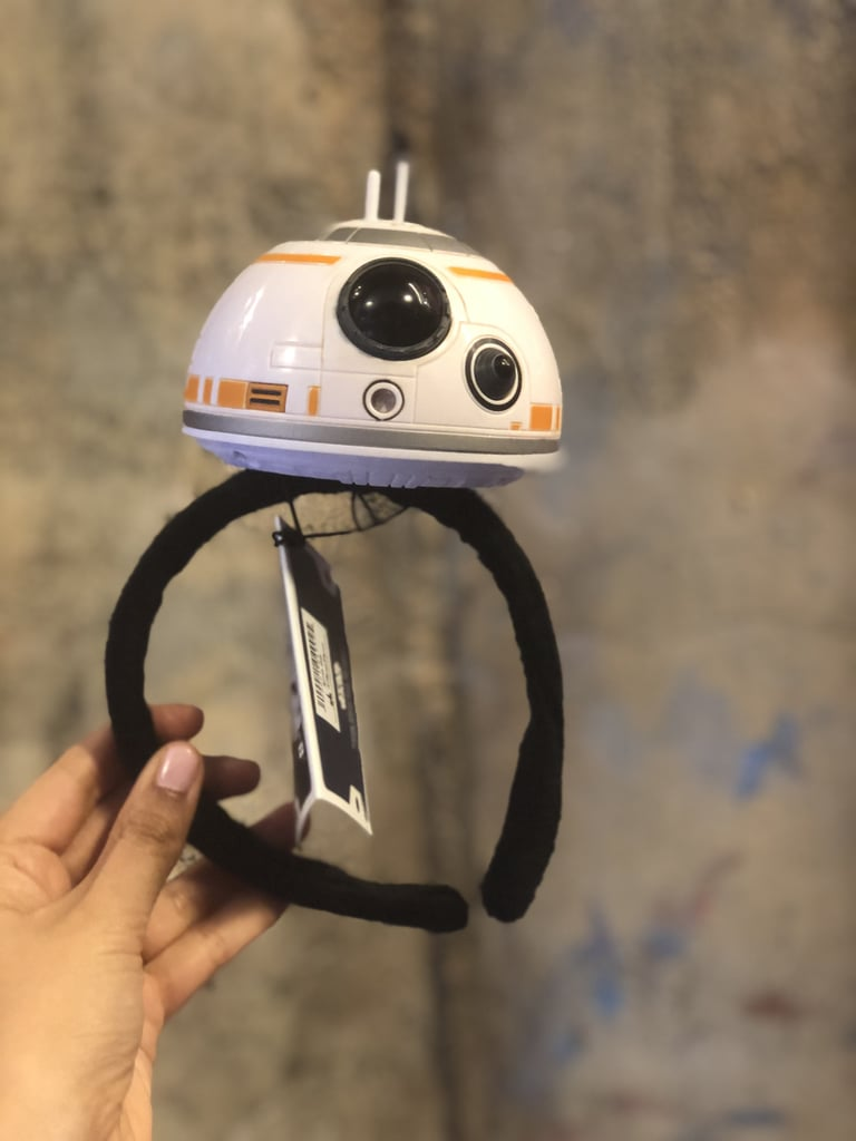 The reasons to love Star Wars: Galaxy's Edge in Disneyland are innumerable, but the out-of-this-world merchandise has to be at the top of the list. Park guests can build their own droids, design their own light sabers, and take home an intergalactic pet from the Black Spire Outpost market. While I couldn't spot any Mickey Ears among the incredible trinkets and toys, I found some items that might be even better — R2-D2 and BB-8 headbands.  Located in the Droid Depot, these adorable accessories feature the fan-favourite Star Wars bots. Each headband even lights up and beeps, just like the droids in the films. If you're not in the market to create a $100 droid, take one of these $30 headbands home instead. They're just as lovable as the droids you see onscreen.       Related:                                                                                                           Get Excited For Out-of-This-World Treats at Disneyland's Star Wars: Galaxy Edge Land