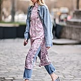 Instead of wearing a top with your denim on denim look, layer in a dress. It's a good way to break up the similar blue tones in your outfit.