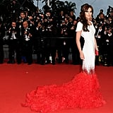The ostrich feather train matched the red carpet.