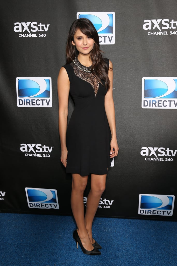 Nina Dobrev slipped into something a little darker than her earlier Zuhair Murad fare for DirecTV's Super Saturday Night party. She chose a lace neckline-infused French Connection LBD, and punched it up with a cool statement collar necklace and black pumps.