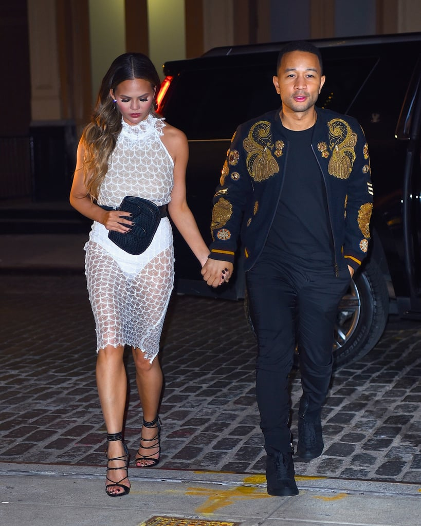 For date night in NYC, Chrissy chose a sheer, lace Zeynep Arcay halter top and pencil skirt while John covered up in an embellished bomber jacket.