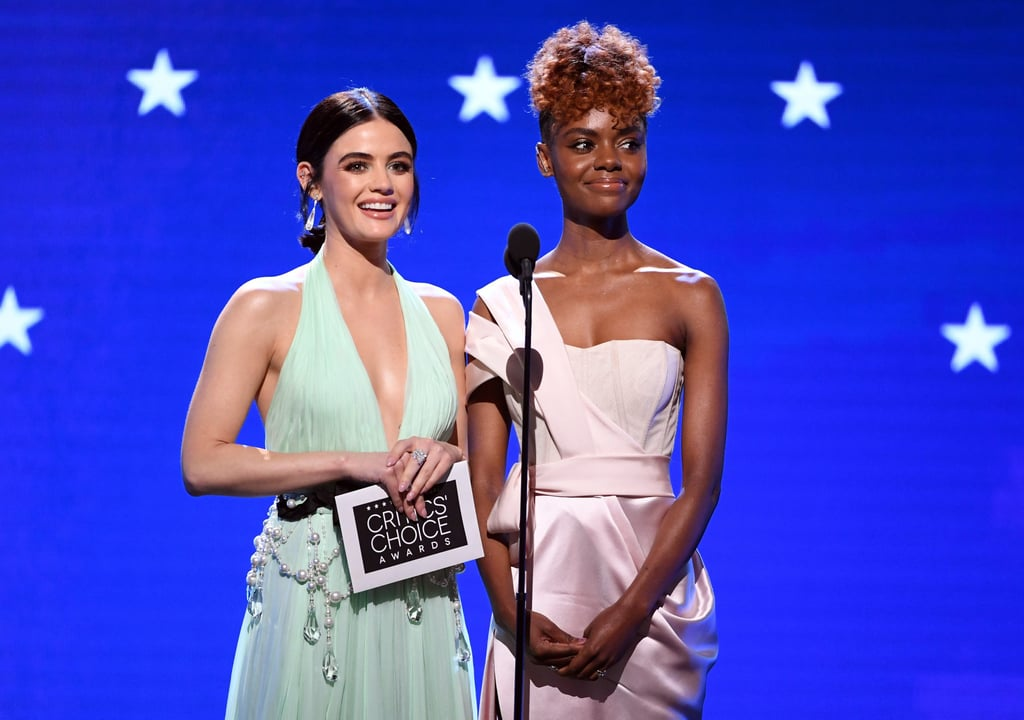 If we could give a Critics' Choice Award for the most endearing presenters, we'd hand it to Lucy Hale and Ashleigh Murray without blinking an eye. On Sunday, the Katy Keene costars took the stage together to deliver the awards for best supporting actor and actress in a drama series. Both stars looked absolutely stunning as Lucy rocked a seafoam custom DKNY dress with glitzy embellishments and Ashleigh modeled a lustrous lavender gown.  Their presentation went smoothly, save for one little flub. While revealing the winners of the categories — Billy Crudup from The Morning Show and Jean Smart from Watchmen — Lucy and Ashleigh weren't exactly in unison while announcing the names. They couldn't help but laugh at the moment, which made it more charming than anything. We're all human, right? Look ahead to see more photos of the adorable duo at the ceremony!