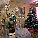 In the Vermeil Room, the holiday decor gets a feminine spin with lovely orchids, pearlescent touches, and even pink accents.
