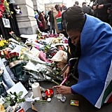 A woman lit a candle to pay tribute to Mandela in the UK.