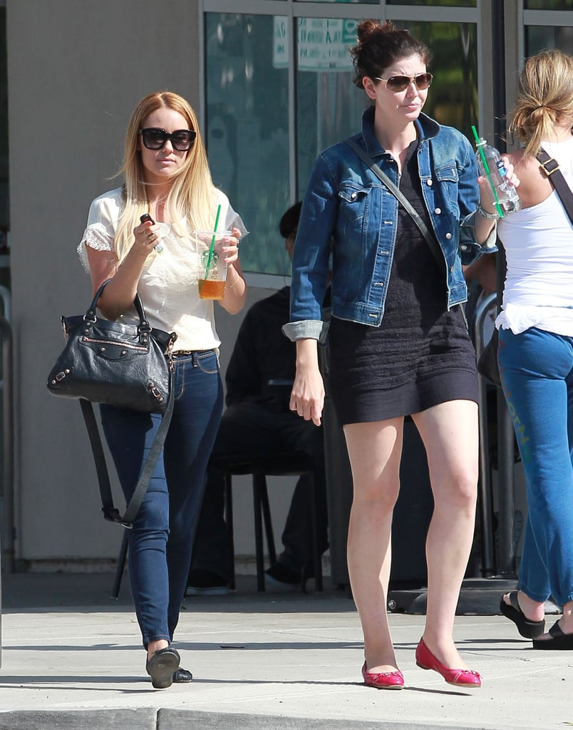 Lauren Conrad and a friend walked out of Starbucks in LA.