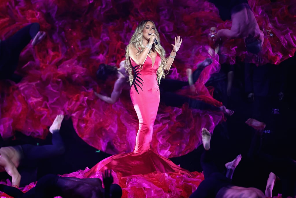 "Mariah Carey brought the heat when she returned to the American Music Awards stage — do you need a second to catch your breath? The 48-year-old singer left the choreography at home when she debuted her new single, ""With You,"" on Oct. 9 and instead let the song's sexy lyrics speak for themselves.  She crooned on stage, decked out in a hot-pink gown and surrounded by shirtless male dancers. Yep, that's the Queen Mariah we know and love. Check out a clip of her song ahead, as well as photos from her sultry performance. We can't wait till she adds this single to her collection of sexy music videos.       Related:                                                                                                           Here Are All the Winners of the 2018 American Music Awards"