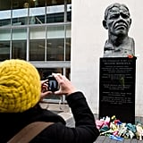 A woman snapped a photo of the Nelson Mandela statue and memorial in London.