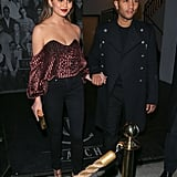 Chrissy's velvet crop top was a bright contrast to John's black military-style peacoat.