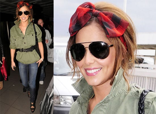 Photos of Cheryl Cole With a Bow in Her Hair at the Airport in Dublin For Tour Supporting the Black Eyed Peas