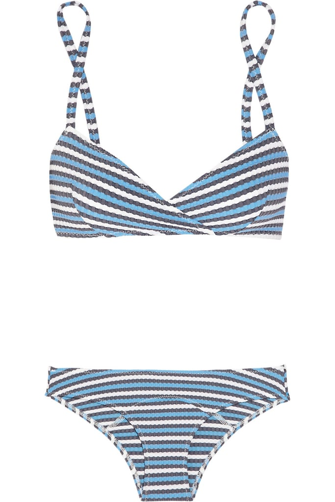 Stripes are a classic, and the silhouette of this twisted top brings a little sex appeal to your nautical vibe. Lisa Marie Fernandez The Yasmin Striped Seersucker Bikini ($435)