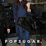 Katie Holmes arrived at LAX on Wednesday toting two black bags.