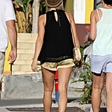 Julianne Hough showed off her legs in a pair of short gold shorts while shopping in St. Barts.