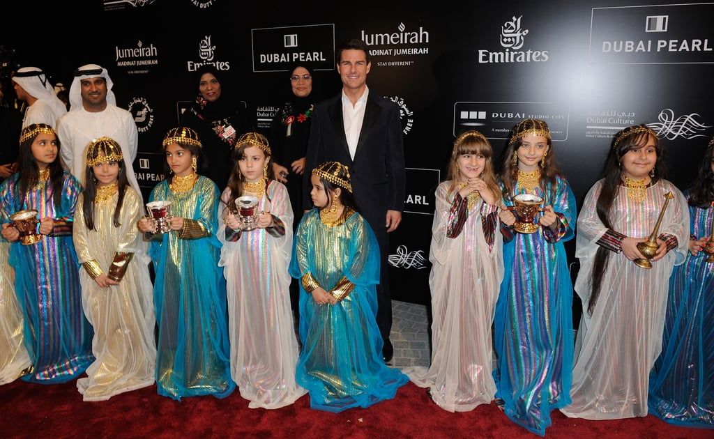 Tom Cruise was greeted by adorable children at the 2011 Dubai International Film Festival.