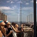 People look up from the Top of the Rock Observatory at Rockefeller Center in New York City.
