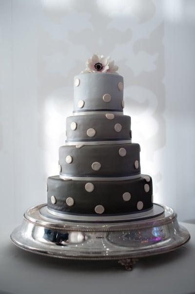 Ombré gray tiers modernize this cake's polka-dot detail.  Photo by Steve DePino via Style Me Pretty