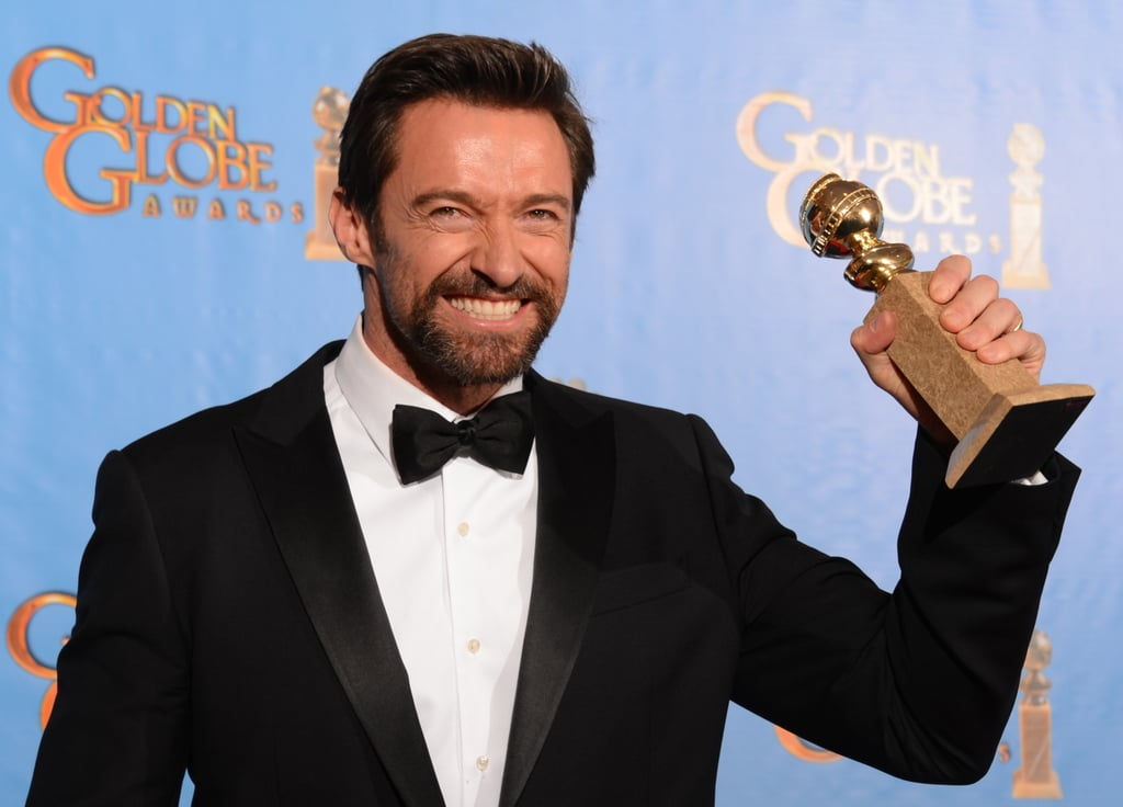 Hugh Jackman held up his Golden Globe statue in the press room.