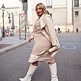 A Neutral, Ribbed Dress With an Oatmeal Trench and White Knee-High Boots