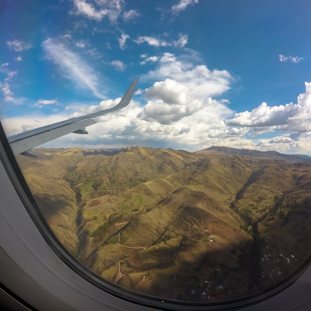 Relish the beauty of the Andes Mountains from your plane side window.