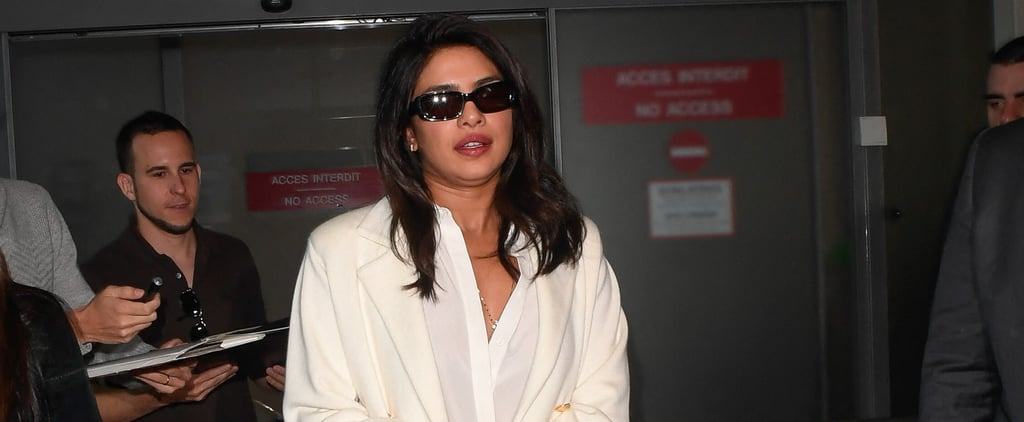 Priyanka Chopra's Big White Bag at Airport in Cannes