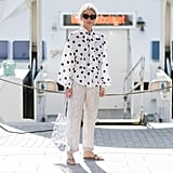 The perfect weekend outfit: a polka-dot top, cropped pants, sandals, and a tote.