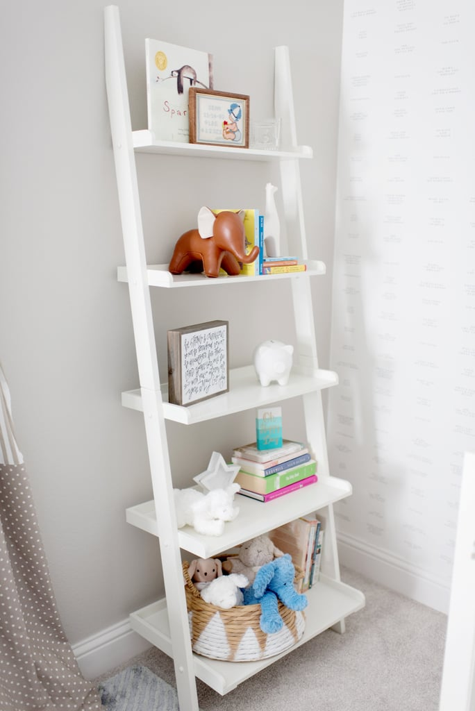"""""""We wanted the nursery to be a haven for the baby, and knowing that this stage would bring a lot of chaos naturally, I definitely felt that creating a calm environment would help even out potential stress,"""" she said.   Leaning Bookcase ($77) Elephant Bookend ($60)"""