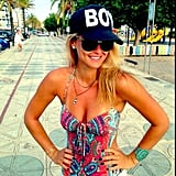 "Bar Refaeli paired her printed swimsuit with a ""Boy"" baseball cap. Source: Instagram user barrefaeli"