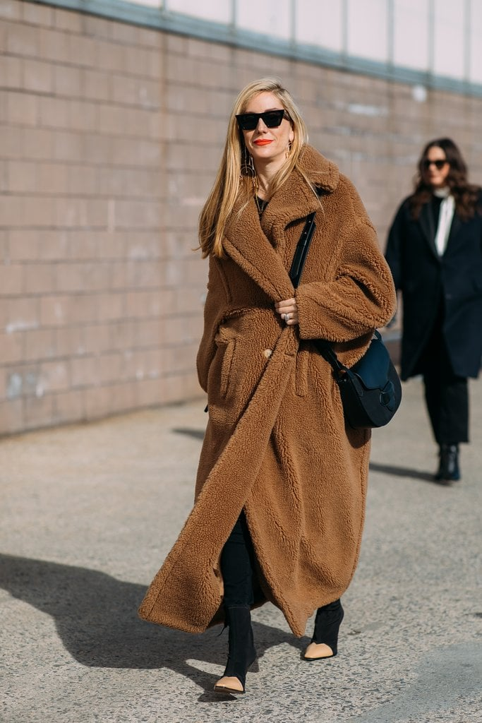 Look cool while staying warm like Joanna HIllman in a teddy bear coat.