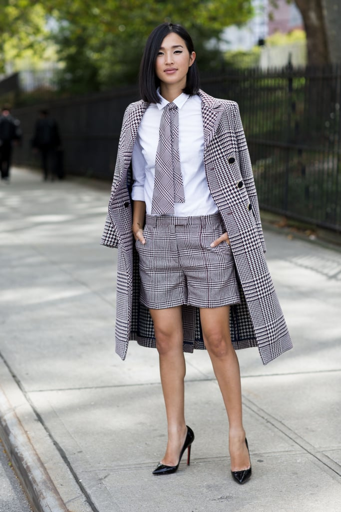 I love how style blogger Nicole Warne has played with masculine tailoring. This look is not for the faint hearted although if pulled off well, it is pretty perfect. The shirt is crisp and white and the houndstooth printed shorts are a great alternative to a skirt. The look is sleek and monochromatic which balances the playful tie, making it one of my favourite office ready looks for summer.