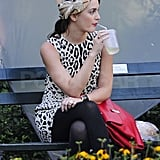 Leighton Meester wore a neutral fascinator paired with her leopard printed dress.