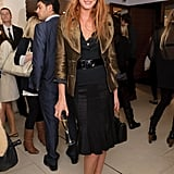 Colour is added to Olivia Inge's black outfit with leopard print shoes and a metallic jacket.
